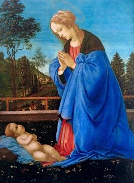 圣母与圣子深情对望,圣母衣服的红蓝两色对比得恰到好处