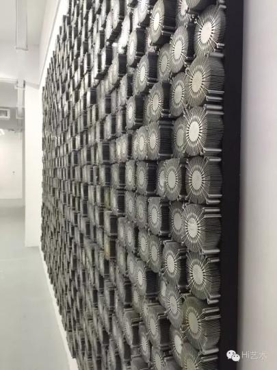 范明正、赵艳婷根据东莞制造业发展现状,特地创作的《东莞制造-太阳花》