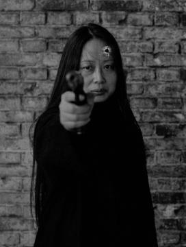 肖鲁 《15枪……从1989—2003》(局部) 摄影、行为 2003年